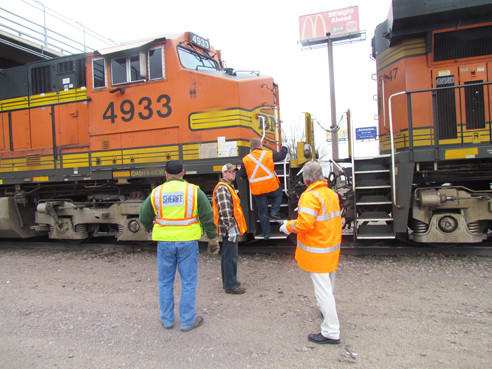 "Sheriff's personnel, state troopers and Aberdeen police officers board a freight train on Thursday as part of BNSF Railway's ""Officer on the Train"" program, which gives law enforcement officials a firsthand view at how pedestrians and vehicles act from a train operator's point of view."
