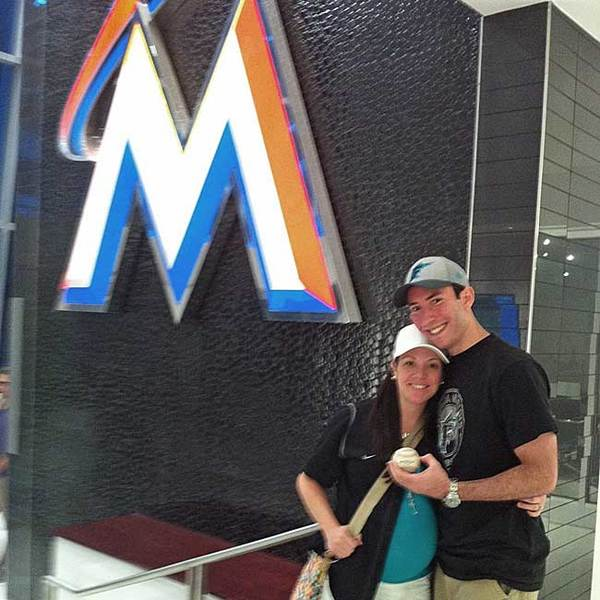 Marlins fan Greg Eisinger of Plantation and his fiancee Caitlin Donato with the first home run ball at Marlins Park.