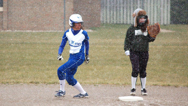 The snow flies during St. Mary's first attempt at playing a game this season on April 10. Area teams are hoping to trade the winter hats for ball caps soon.