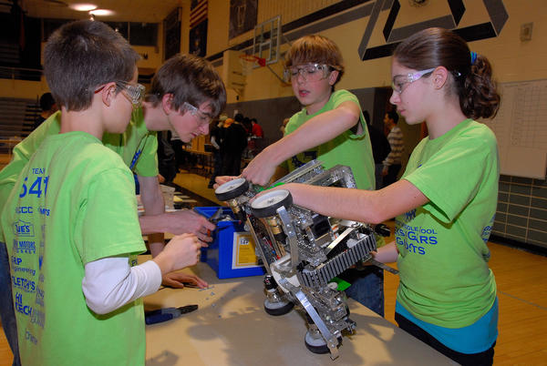 The Petoskey Middle School robotics team wins the first competition it took part in, pictured here at the West Michigan FIRST Tech Challenge in Holland. Students (from left) Noah Degen, Cameron Brown, Max Meyerson and Taylor Brown work on their teams robot. The G3 team is headed to world competition next week in St. Louis, Mo.