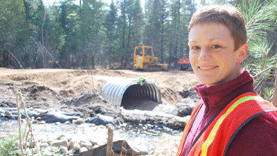 Project manager Abigail Ertel oversees a road/stream crossing improvement project at Little Crapo Creek. Photo by Chris Engle