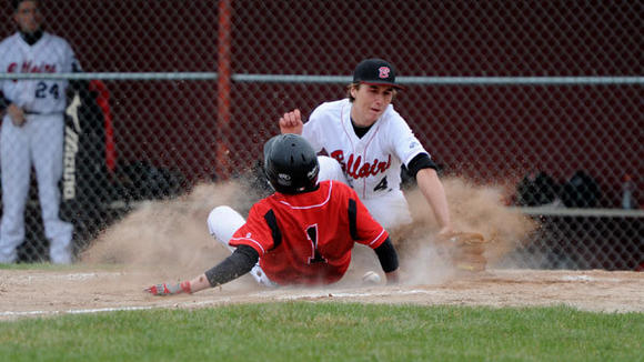 J-L sophomore Coalton Huff slides into third base during the Cardinals' doubleheader split with Bellaire Thursday.
