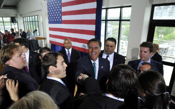 Republican presidential candidate and former Massachusetts Gov. Mitt Romney greets supporters during a campaign stop on April 18, 2012 in Charlotte, North Carolina.