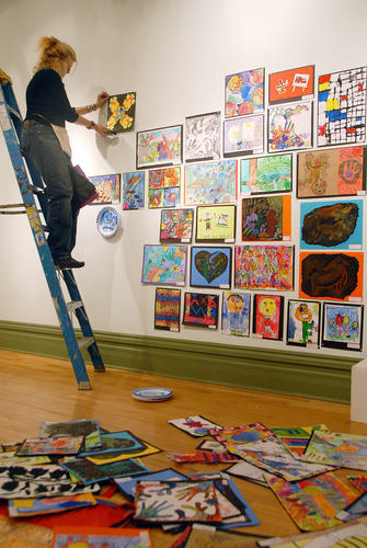 With a pile of artwork on the floor, Pellston schools art teacher Erika Faust, hangs the work of her students at Crooked Tree Arts Center in Petoskey, Wednesday. Student art from Charlevoix and Emmet counties will fill the walls of the center when the 2012 Youth Art Show opens with a reception 2-4 p.m. Saturday, April 21. There will be an award presentation at 2:30 p.m. and the work will be on display through Saturday, May 12.
