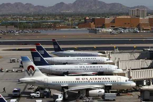 US Airways gains support for merger from three American Airlines unions