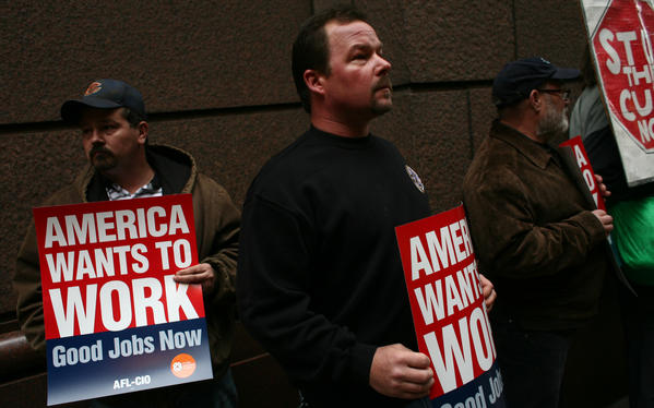 Scott Granko, middle, of Mokena, Ill., a Union member of Sheet Metal Workers Local 73 in Chicago, protests Wis. Gov. Scott Walker, who is Chicago to speak at the Illinois Policy Institute luncheon.