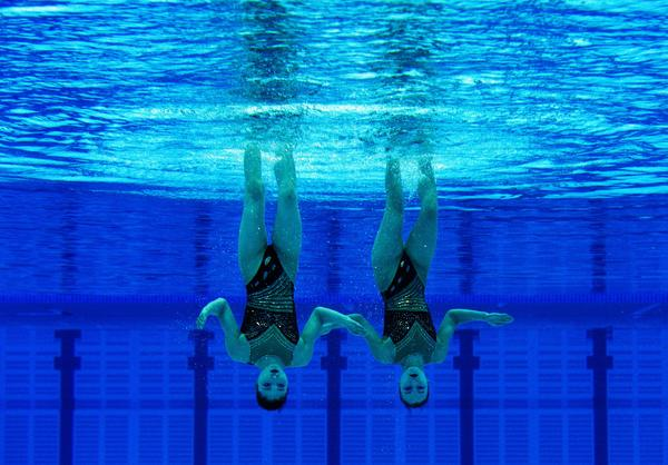 Jang Hyang Mi and Jong Yon Hui of the People's Republic of Korea compete in the duets free routine during the FINA Olympic Games Synchronised Swimming Qualification competition.
