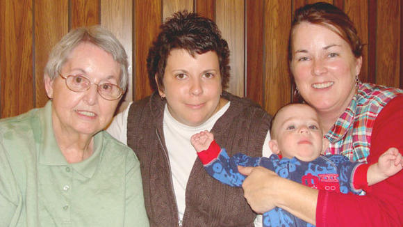 Family and community are important to Vicki Modrzynski (second from left) here with her grandmother, Dorothy George, infant cousin, DJ, and aunt, Deanna Kehl.