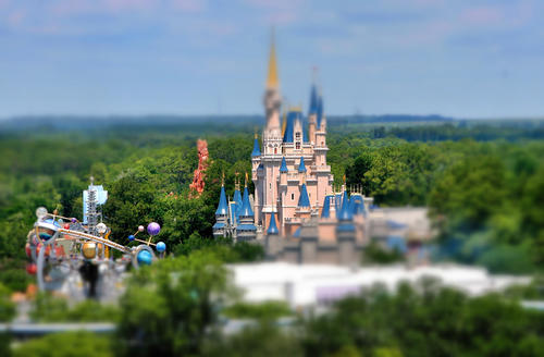 "Looking like a toy model, a  view of Cinderella Castle from Bay Lake Tower at the Contemporary Resort, Wednesday, May 27, 2009. This image was manipulated in post-photography editing, using a ""tilt-shift"" filter, to mimic the effect of traditional miniature photography."