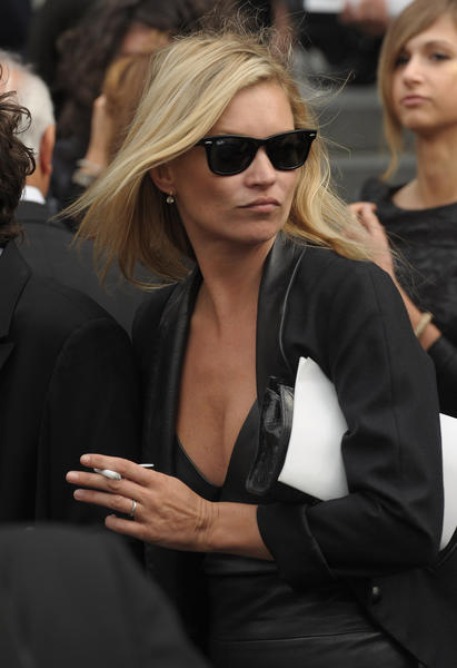The model can typically be seen sporting Ray Ban Wayfarers.