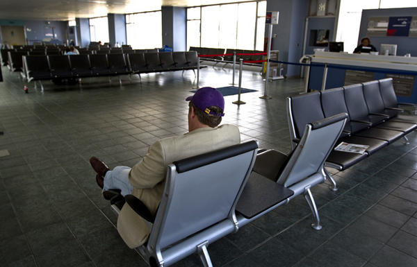 Passenger travel is down 30 % in March even with nine days of AirTran service. April is projected to be down 35% and could be up to 50% this summer. The airport has laid off 15 this week, skycaps parking lot attendants etc. Proposed budget to be adopted next week will be 25% below the current budget.