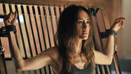 """Nikita""returns after a long hiatus Friday, and although the episode titled ""Wrath"" has plenty of action, it also allows stars Maggie Q and Shane West to show just how much their characters care for each."