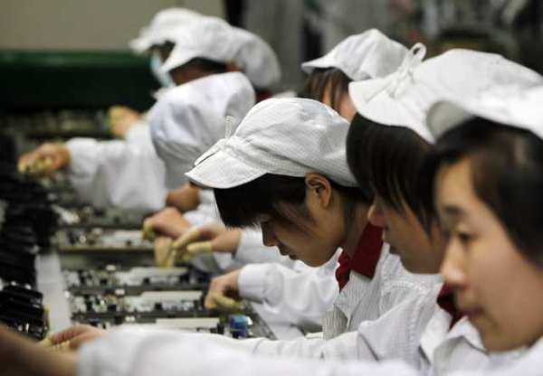 Staff members work on the production line at the Foxconn complex in the southern Chinese city of Shenzhen. The company manufactures Apple's iPhones and iPads.