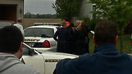 Photos of the arrest in Elburn, Ill., snapped by WGN News viewer Brad Hruza show his neighbor, 32-year-old David Ziesel, hauled in by police, ending a long and bizarre chase that began with an armed robbery of a bank 109 miles away in LaPorte County, Ind.