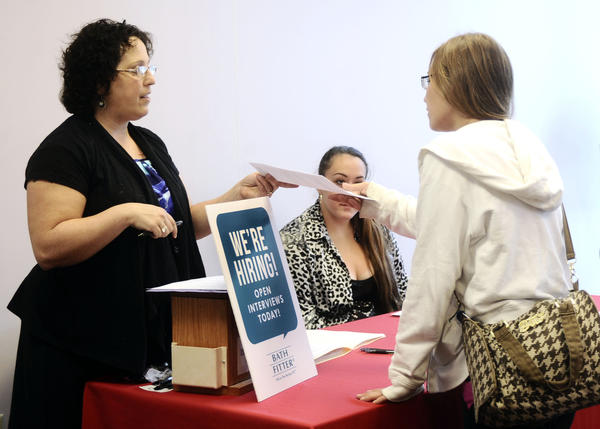 Penny Horner, left, of Bath Fitters takes Jennifer Wagner's application at the Job Fair held on Friday from 10am-1pm at the Washington County One-Stop Job Center located in downtown Hagerstown.