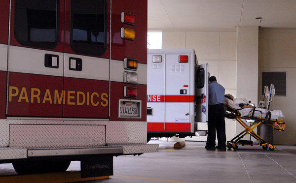 A patient is removed from an ambulance at Huntington Hospital in Pasadena.