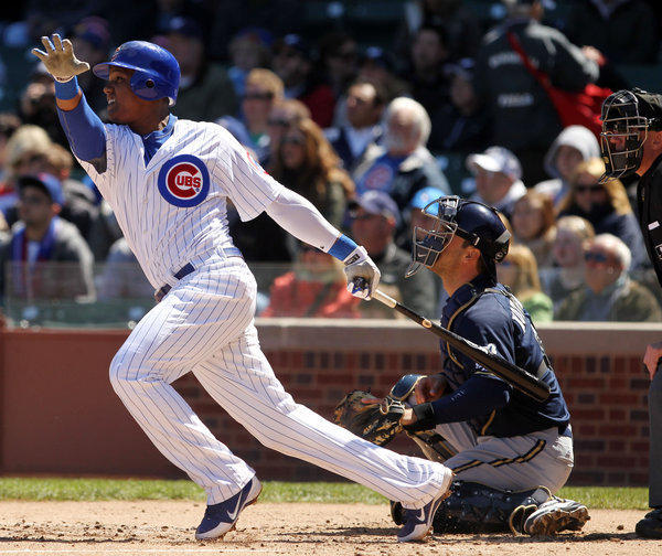 Chicago Cubs shortstop Starlin Castro (13) hits a sacrifice fly at Wrigley Field on April 11, 2012.