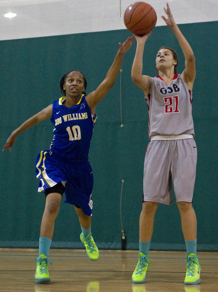 Boo Williams' Adrienne Motley defends a shot by GSB Elite's Miyah Leith during the first half of Friday's game at the 2012 Boo Williams Nike Invitational Tournament.