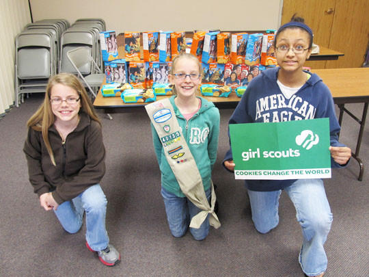 Girl Scouts Troop 40135 donated 32 boxes of Girl Scout cookies to the military through the Cookie Share Program. The girls asked customers if they would like to buy extra boxes to be donated to their favorite cause ¿ the men and women serving in the military. From left are troop members Leah Norton, Mariah Brandner and Hannah Peterson. Not pictured: Sarah Zens.