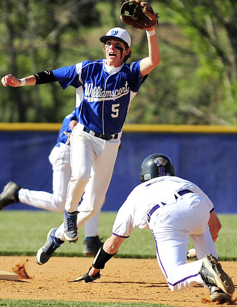 Williamsport's Brandon Greene (5) leaps but can't grab a high throw as Smithsburg's Brad Spickler, right, slides into second base during Friday's MVAL Antietam baseball game.