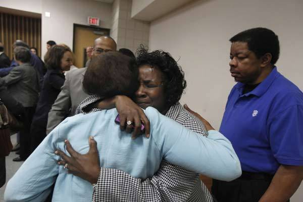 Shirley Burns, center, hugs her friendy after Cumberland County Senior Resident Superior Court Judge Greg Weeks found that racial bias played a role in the trial and death row sentencing of Burns' son inmate Marcus Robinson.