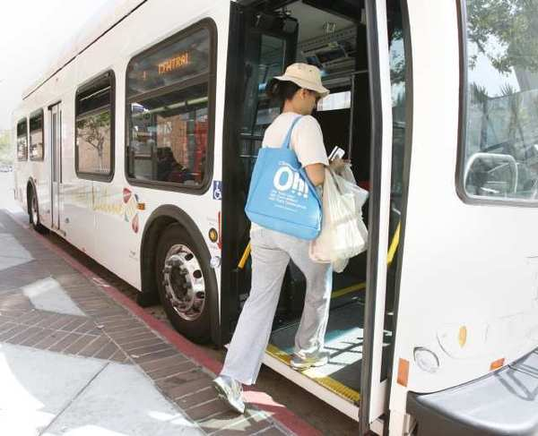 A woman gets on a Glendale Beeline bus on Brand Boulevard near Broadway.