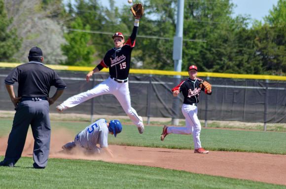 Great Bend senior Jace Bowman skies for a throw as Junction City's Cody Devin slides safely into second Saturday.