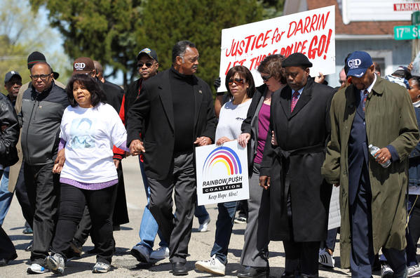 Jesse Jackson, center, leads a march to North Chicago's City Hall against alleged police brutality.