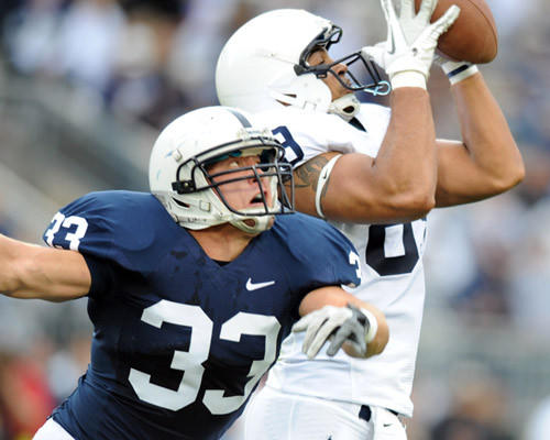 Blue's Jesse Della Valle breaks up a pass to White's Garry Gilliam at the annual Blue-White at Beaver Stadium in University Park on Saturday.
