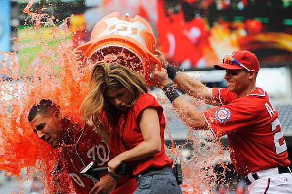Ian Desmond #20 of the Washington Nationals is doused with Gatorade by his teammates after hitting the game winning sacrifice fly to center in the bottom of the tenth inning against the Miami Marlins at Nationals Park on April 21, 2012 in Washington, DC.