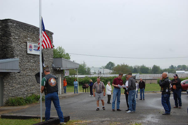 Local veterans gather Saturday as the flag is raised at the new AmVets facility on Stanford Road.