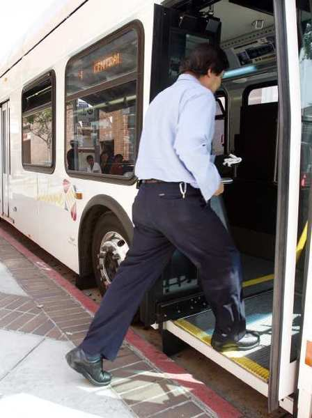 A Glendale Beeline bus driver returns to his bus on Brand Boulevard. Transportation officials are working on a $754,000 website to make it easier for commuters to find routes through Glendale, Burbank, La Canada and Pasadena.