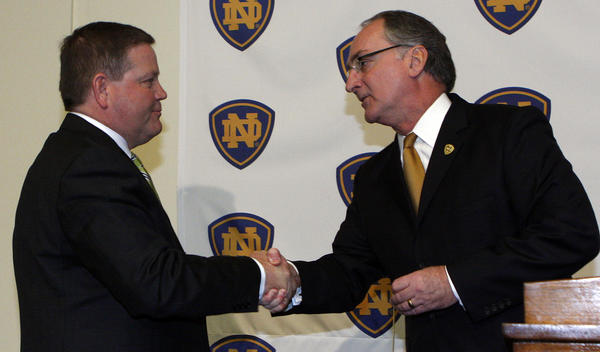 Notre Dame atheletic director Jack Swarbrick greets coach Brian Kelly.