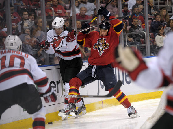Florida Panthers Shawn Matthias battle New Jersey Devils Alexei Ponikarovsky for control of the puck during the first period.