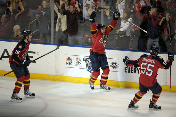 Florida Panthers Scottie Upshall celebrates scoring a goal with his teammates  during the third period against the New Jersey Devils.