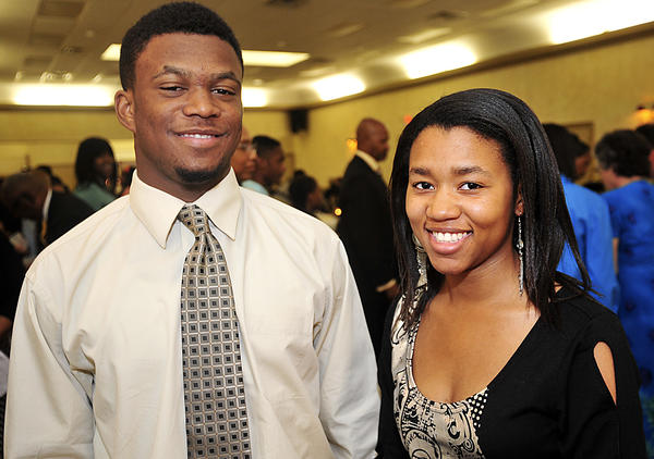 Ahmere Ware, 17, left, and Tytianna Cooper, 17, both of Hagerstown, are seniors receiving a scholarship from the Hagerstown YMCA's Achievers program Saturday.