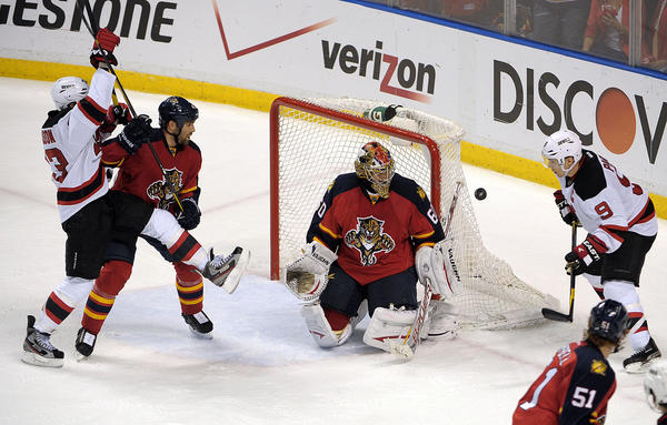 Florida Panthers goalie Jose Theodore stops the puck in front of New Jersey Devils Zach Parise during the third period.