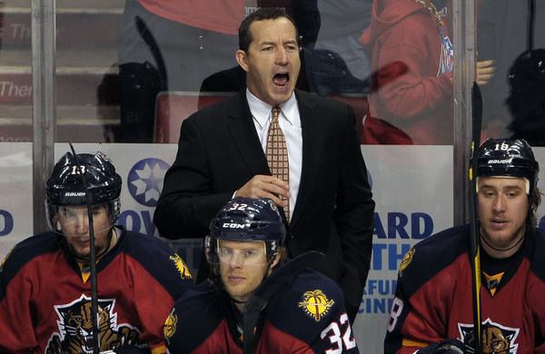 Florida Panthers Head Coach Kevin Dineen shouts instructions to his players during the third period against the New Jersey Devils.