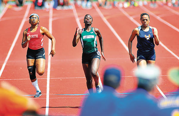 South Hagerstown's Elizsha Streeter, center, races to a second--place finish in the girls 100-meter dash Saturday.