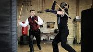 Michael Mauch, left, of Chicago battles instructor Trey Ptak, right, during Bartitsu class at Forteza Fitness in Chicago