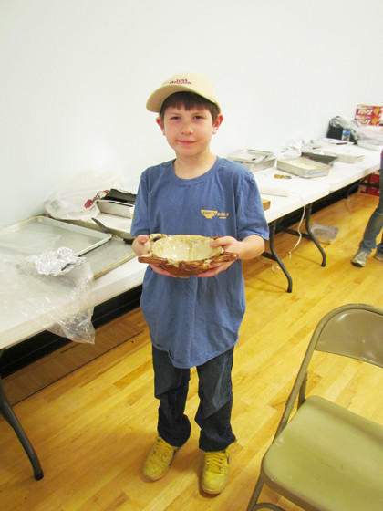 John Reynan, 9, shows off the bowl he made for the Empty Bowls fundraiser dinner on Saturday in Aberdeen.