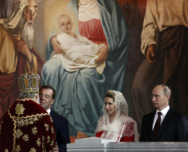 Russian Orthodox Patriarch Kirill exchanges kisses with President Dmitry Medvedev as Medvedev's wife, Svetlana, and President-elect Vladimir Putin await their turn at an Easter Sunday service in downtown Moscow.