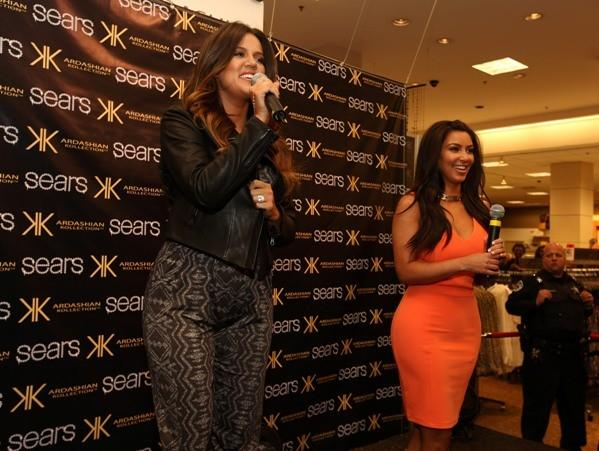 Khloe Kardashian-Odom (left) and Kim Kardashian greet fans before signing autographs at Sears in Woodfield Mall in Schaumburg April 20, 2012.