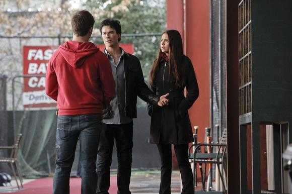 Ian Somerhalder and Nina Dobrev confer with Steven R. McQueen.