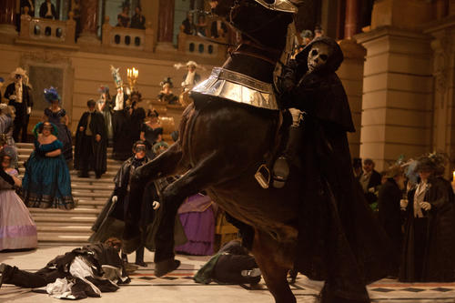 "Terrified guests scatter as a masked rider storms Captain Hamilton's ball in ""The Raven"""