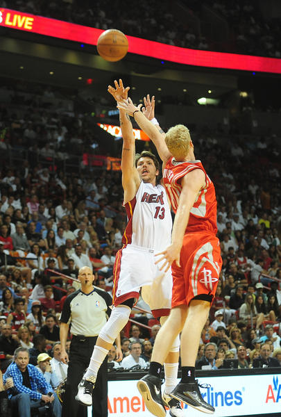Miami Heat Mike Miller shoots over  Houston Rockets Chase Budinger in during the second quarter of the last home game, Sunday, April 22, 2012 at the AmericanAirlines Arena in Miami.