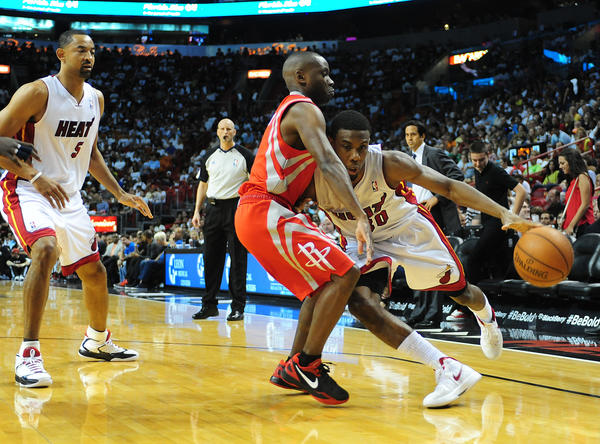 Miami Heat Norris Cole drives past the Houston Rockets Earl Boykins during the second quarter of the last home game, Sunday, April 22, 2012 at the AmericanAirlines Arena in Miami.