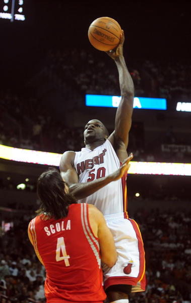 Miami Heat Joel Anthony scores over Houston Rockets Luis Scola  during the first quarter of the last home game, Sunday, April 22, 2012 at the AmericanAirlines Arena in Miami.