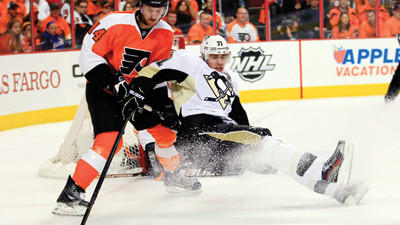 Philadelphia Flyers Sean Couturier, left, takes Pittsburgh Penguins Evgeni Malkin off the puck near the Flyers net during the first period in Game 6 on Sunday.