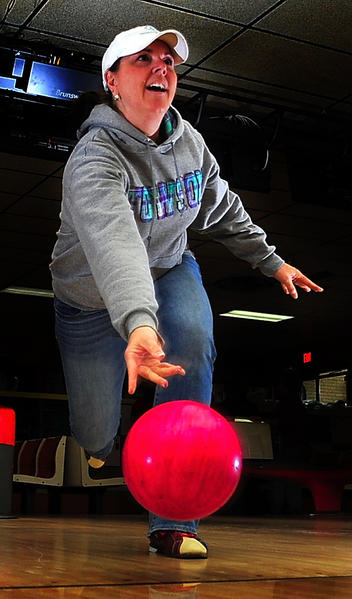 Kris McGee rolls Sunday during the Bowl for Kids' Sake fundraiser at Turner's Dual Lanes in Hagerstown. She was part of a team from Bester Elementary School.